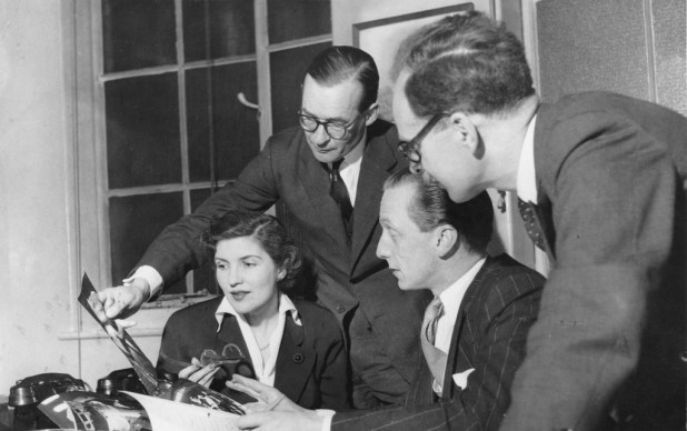 "Above: Happier days for the Eagle team, seen here in a photo published in the comic in April 1954. Left to right: Ellen Vincent, assistant editor; Macdonald ""Max"" Hastings, Eagle 'Special Investigator'; Marcus Morris, the editor; and Michael Gibson, art editor. From Michael Gibson's collection of photos and ephemera."
