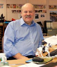 Bill Graham at his desk at DC Thomson