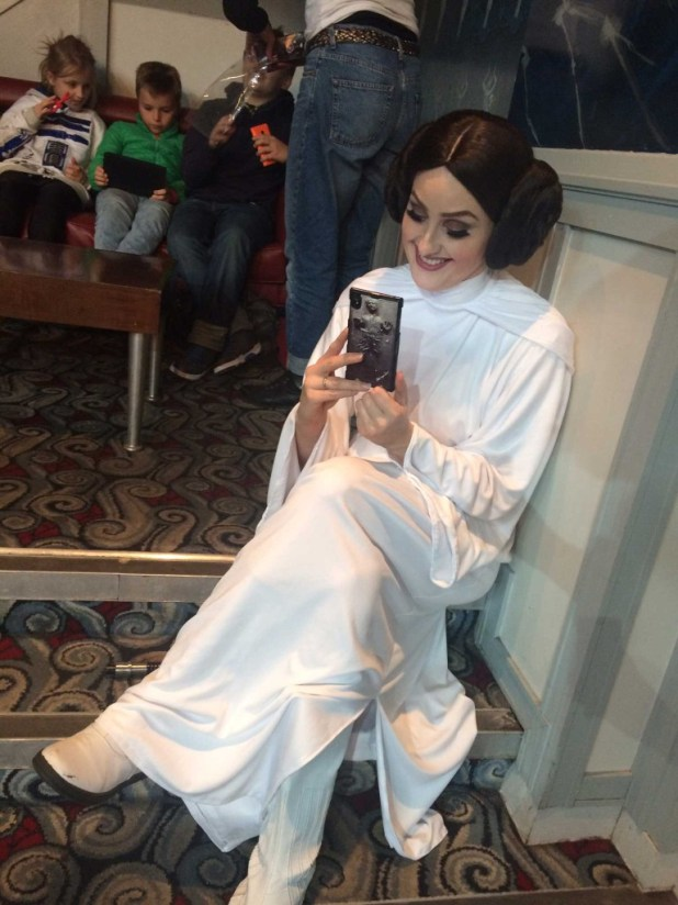 A Star Wars fan delights in a Star Wars find at Leamington Comic Con. Photo: Antony Esmond