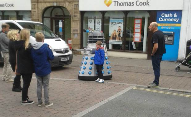 Plenty for kids to enjoy at LICAF - including getting snapped with a Dalek. Photo: Norman Boyd