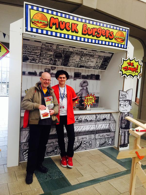 You;re never too old to win a Muckburger from Zoom Rockman! John Freeman with Zoom at the Lakes International Comic Art Festival. Photo: Kate Lennard