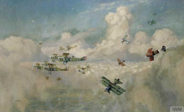 Closing Up A Bombing Formation of British Biplanes (DH9a s) Closing Up to Beat Off an Enemy Formation of Fokker Triplanes GH Davis 1919 © IWM (Art.IWM ART 3071)