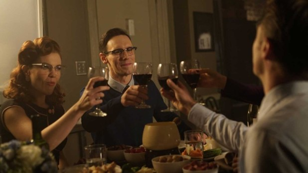 Chelsea Spack as Kristen Kringle and Cory Michael Smith as Edward Nygma (the Future Riddler) at a dinner party with James Gordon (Ben McKenzie) and Dr. Leslie Thompkins (Morena Baccarin)