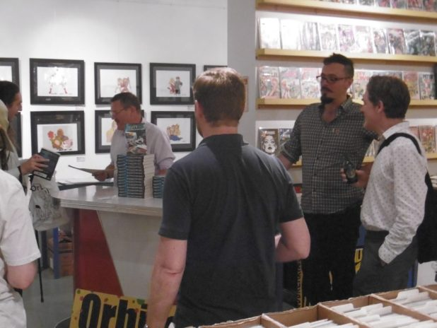 Artist Rian Hughes chatting with 2000AD's Michael Molcher. Photo: Richard Sheaf