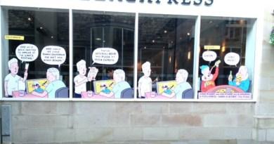 "Luke McGarry's ""Windows Trail"" art in the window of Kendal's Pizza Express"