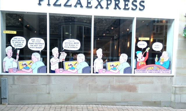 "Luke McGarry's ""Windows Trail"" art in the window of Kendal's Pizza Express"
