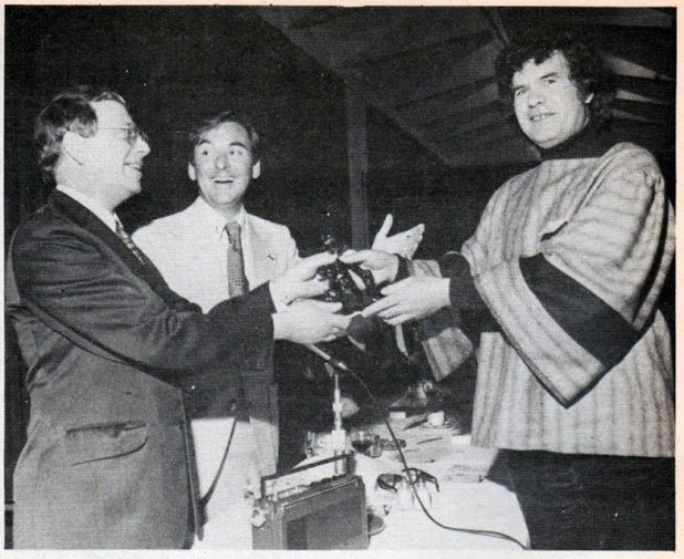 "1976. Leo Baxendale receives the Ally Sloper Award at ""Comics 101"" from Bob Monkhouse and Denis Gifford."
