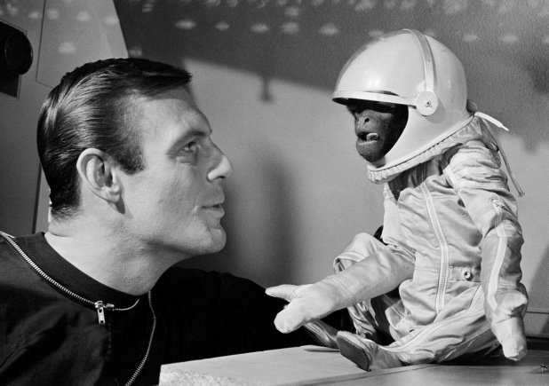 """Adam West with with """"Barney the Woolly Monkey"""" in the 1964 film Robinson Crusoe on Mars"""
