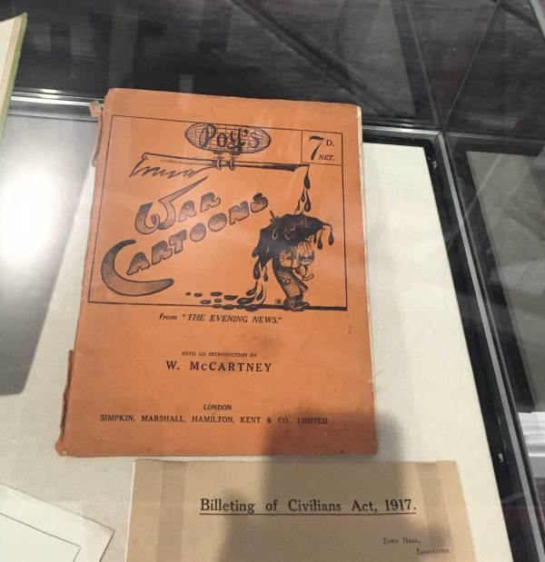"Along with paintings from the Museum's huge collection of King's Own -related art, there's also memorabilia such as this intriguing-looking :War Cartoons"" book on display"