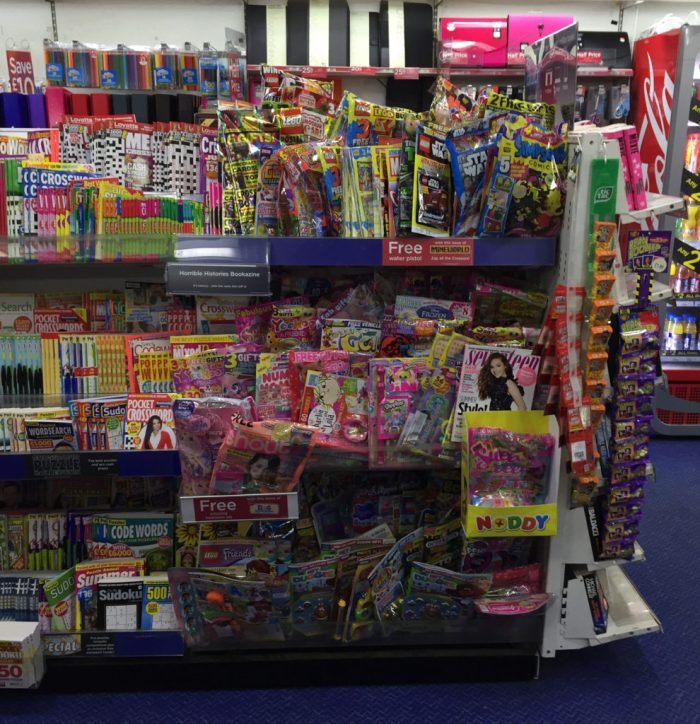 The children's magazine section of a typical mid-range WHSmith, July 2017. Because WHSmith have given over much shelf space to non-magazine items in this store the comics are cramped and many are at adult height, limiting purchase choice for younger buyers - a far cry from past decades when all comics were within easy reach in newsagents to encourage a pocket money spend.