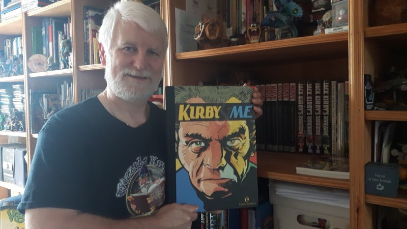 Tim Perkins with a copy of the tribute book Kirby and Me