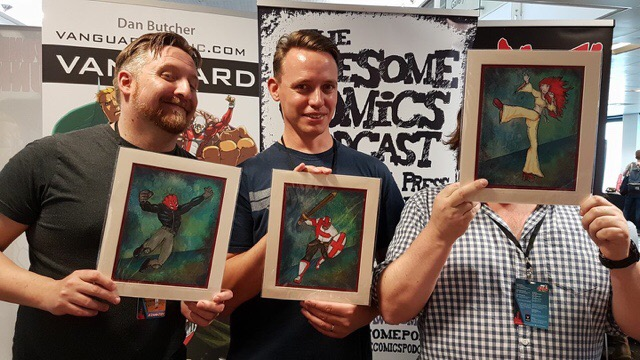 The Awesome Comics Podcast team at LSCC 2017 with some art by Sarah Harris