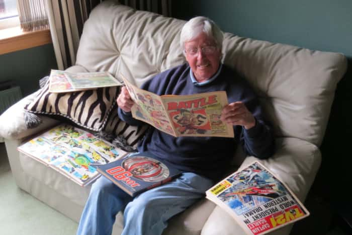 Comic artist Jim Watson, surrounded by some of the comics he worked on. Image: The Scotsman