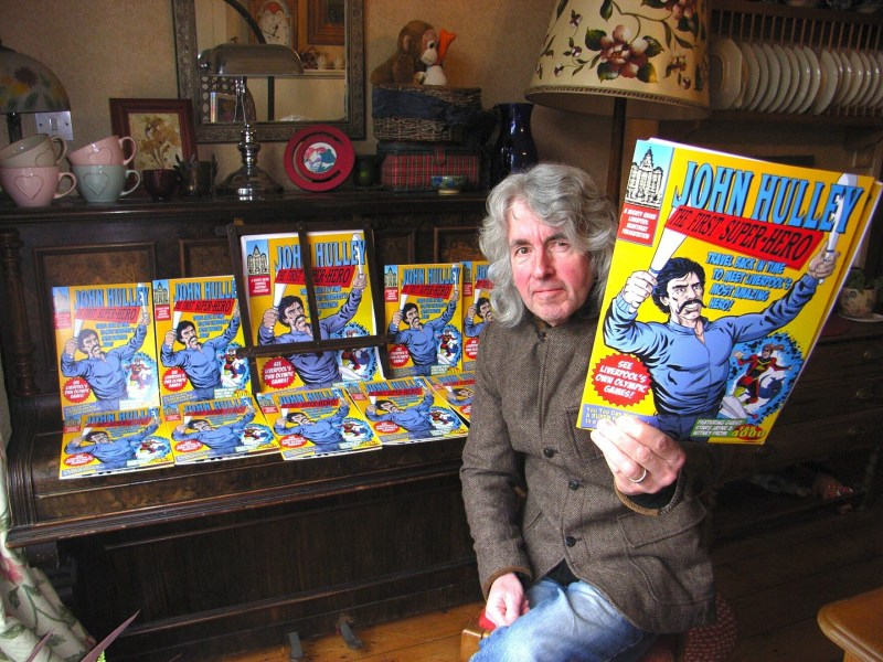 Tim Quinn with copies of the latest FAB 4000 comic
