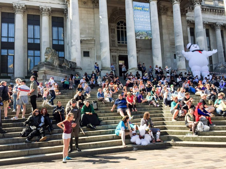 Enjoying the sun: Portsmouth Comic Con attendees on the steps of the Guildhall
