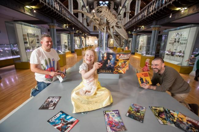 Glasgow's Hunterian is to host comics-themed Night at the Museum. Pictured are Professor Laurence Grove (left) and comic artist Frank Quitely (right), with Anna Smeaton, aged 7. Photo: Martin Shields /University of Glasgow PR)
