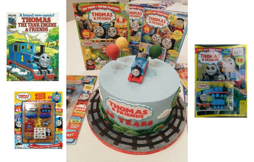 "A celebration Thomas & Friends cake and the first issue of the magazine published by Marvel UK as Tank Engine ""Thomas and Friends"" in 1987 and the current issue of ""Thomas and Friends"" (Issue 756)"