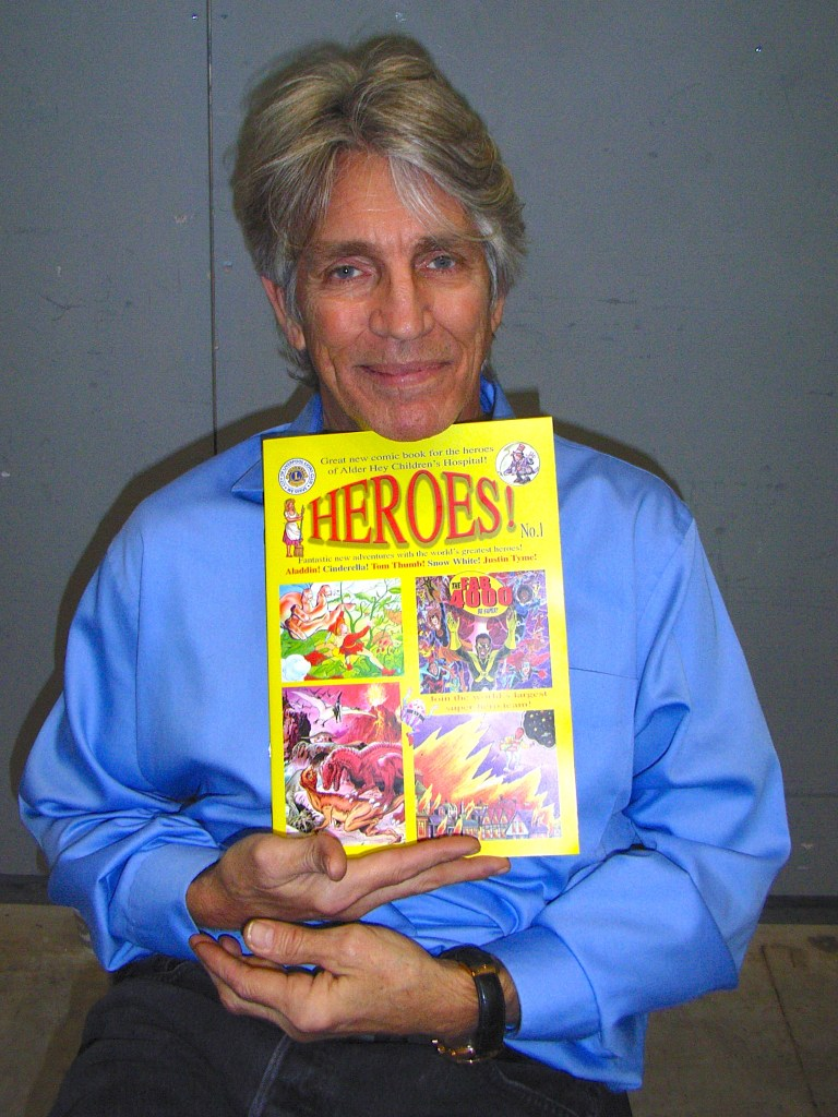 Star of movies and TV series, the one and only Eric Roberts got himself a copy of the Liverpool Lions Club's great new comic book 'HEROES!' this weekend. No wonder he's smiling! Eric is the brother of that 'Pretty Woman' Julia Roberts.