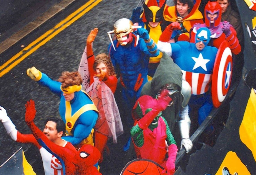Marvel UK staff taking part in the 1993 London Lord Mayor's Parade. Captain America was played by editor Stuart Bartlett; Cyclops, by designer Gary Gilbert; Death's Head II by artist Liam Sharp; Magneto by editor and writer Alan Cowsill; and Doctor Strange by Tim Quinn