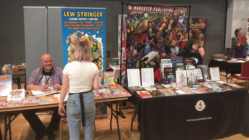 Lew Stringer chats with an attendee at Oldham Comic Con 3. Photo: Ian Loxam