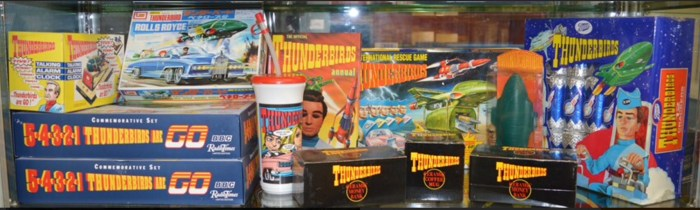 A collection of Thunderbirds items, which includes; 2 Limited Edition Commemorative sets, International Rescue game and more