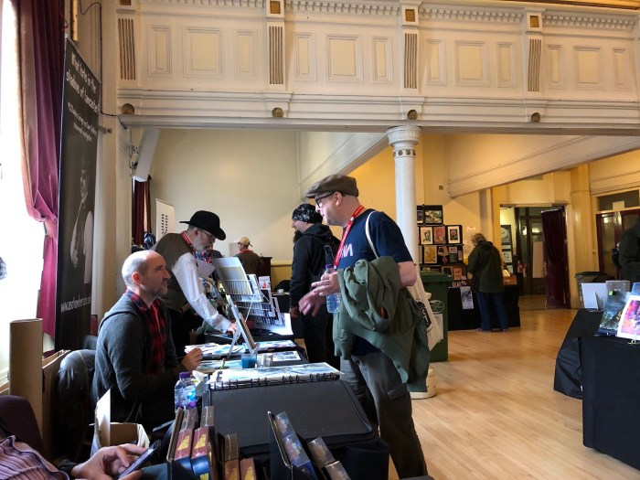 Keith Burns chatting with fellow artist Michael Lark at LICAF 2019. Photo: John Freeman