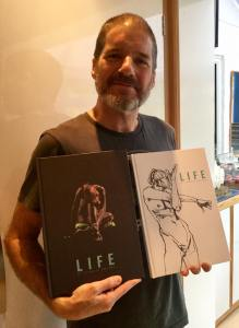 Charlie Adlard with copies of his LIFE drawing collection