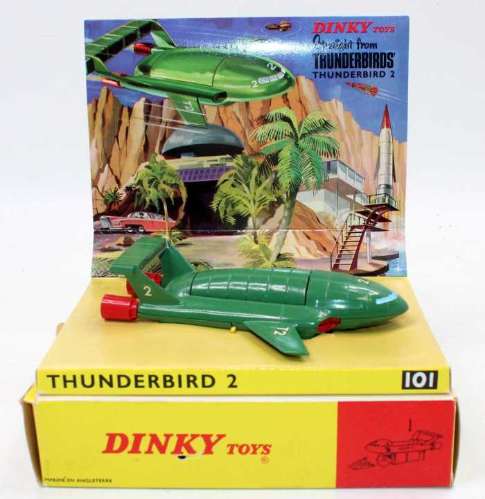 Dinky Toys No.101 Thunderbird 2, comprising of green body with four yellow plastic legs and red rear boosters, complete with capsule containing Thunderbird 4, housed in the original sliding tray box with packing piece and sliding card section