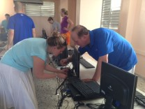 Jay and Sarah working on one of the laptops at th Herrera school