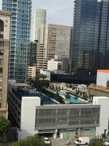 LEVEL's pool deck and basketball court sit on top of parking structure with new DTLA day spa on street level.