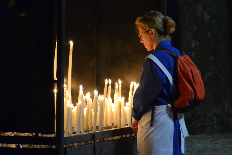 why do catholics light candles