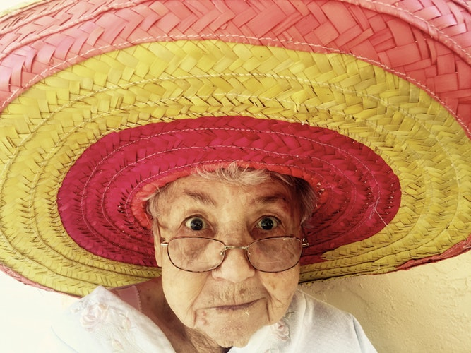 An old lady in a bright sombrero