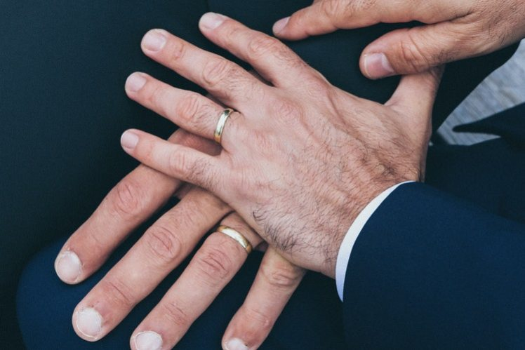 A wedding picture showing the wedding rings