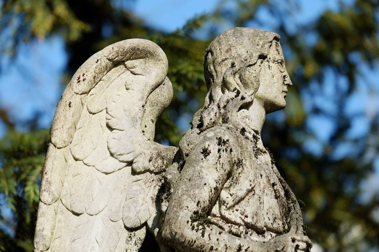 A stone angel in a graveyard.