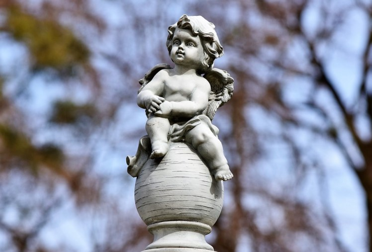 A cherub in a cemetery.