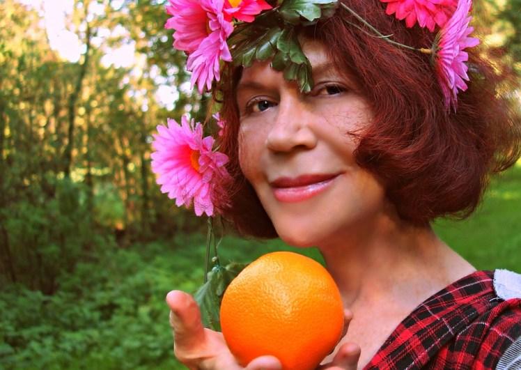A flower child with an orange.