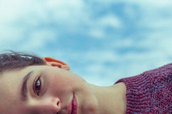 Young girl lying down.