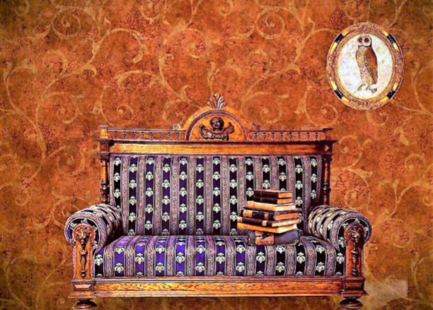 An beautifully upholstered antique wooden love seat with a paisley brown wallpaper in the background.