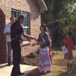 Major Stokes presented the family with bread, one of the symbolic gifts.