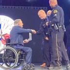 Dallas Police Chief, Eddie Garcia, greets Governor Gregg Abbott with a handshake.
