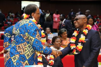 Deputy Prime Minister of Namibia Nandi-Ndaitwah Netumbo,\ and Guyana's Foreign Affairs Minister Carl Greenidge, greet each other before the ACP Plenary session