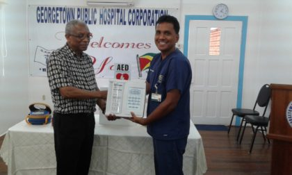 Dr. James Cort, member of the Fyrish/ Gibraltar/Courtland Support Group handing over medical equipment to Dr. Zulificar Bux, Head of the Georgetown Public Hospital Corporation's Accident and Emergency Unit