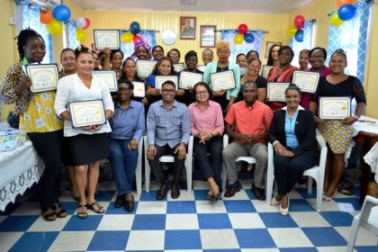 From left: Facilitator, Mr. Yohann Pooran, First Lady, Mrs. Sandra Granger, Mayor of Bartica, Mr. Gifford Marshall, Deputy Mayor, Ms. Kamal Persaud and the 26 participants of the Self Reliance and Success in Business Workshop.