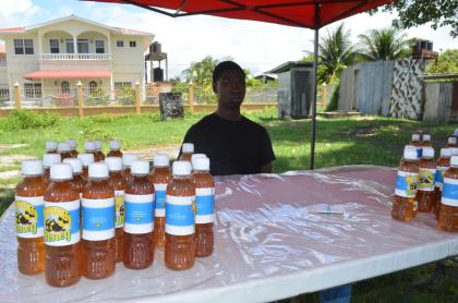 Akeem Williams with some of his honey products