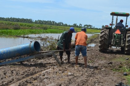 A tractor-driven pump working to assist in draining water in Region Five