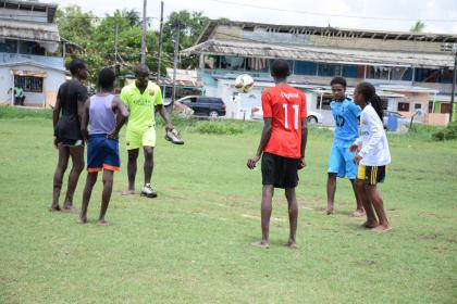 Members of the Ruimveldt inter-area youth community football group