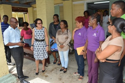 First Lady, Mrs. Sandra Granger (second from left) is pictured among Pastor Sean Sobers, the matron and care-givers at The Palms Geriatric Home and representatives from the Women Across Differences group.