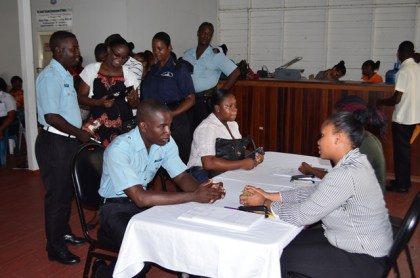 Staff of the Central Planning and Housing Authority going through the allocation process with the ranks