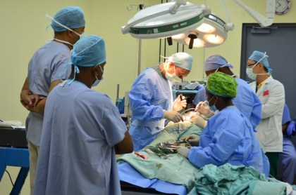 The Chinese Medical Team performing a spinal surgery on a patient at the New Amsterdam Hospital