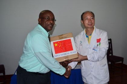 Dr. Wang Yongxiang, Head of the Chinese Medical Brigade handing over the medical equipment to Colin Bynoe, Chief Executive Officer (CEO) of the New Amsterdam Hospital